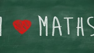 I love maths phrase handwritten on the school blackboard